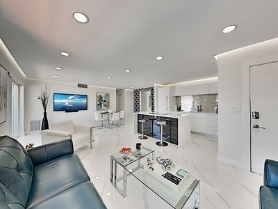Photo for Luxe Parkview Corner Unit w/ 2 Balconies, Garage Parking - Half-Mile to Beach