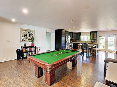 Game Room - Play a round of billiards at the pool table in the game room.