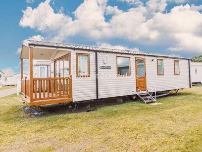 Photo for 2 bed, 6 berth caravan at Haven Seashore holiday park with decking.
