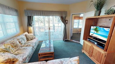 Photo for Delightful and Roomy Condo overlooking #8 Maples - Close to Pools!
