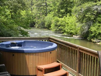 Soak in the hot tub and listen to the Cartecay River below