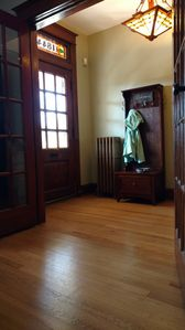 Historically renovated entryway, gorgeous and open wood floors.