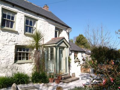 Photo for High quality cosy quirky cottage with hot tub in idyllic hamlet nr Helford.