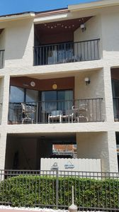 Unit #28 balconies directly overlook the pool! Parking space under lower balcony