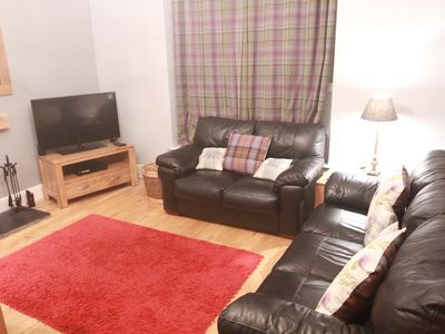 Photo for Relax in this luxury renovated flat with a hot tub and log burner