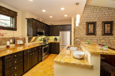 Large, fully stocked kitchen with all the modern amenities of luxury living