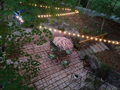 Patio as seen from above. Seating,flowers,fire pit, fireplace, view of  Lookout
