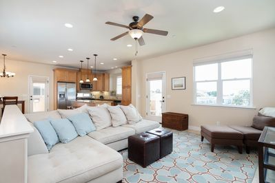 Welcome to our beach house. Living room has sectional seating for family and friends to gather around TV. Open the nearby door for balcony seating and let the fresh ocean breeze move through the home.