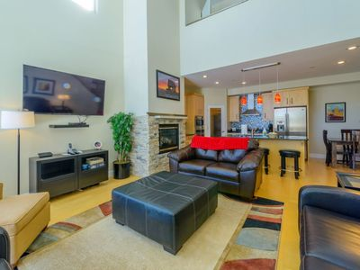 Photo for Modern condo right across the street from the lifts, shopping, and restaurants. Relax in your oversi