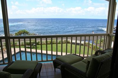 Relax in lounge seating or dine at the bar height table on the spacious lanai.