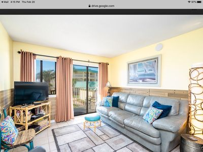 Living room right next to indoor pool, sauna, steam room, hot tub, fitness area