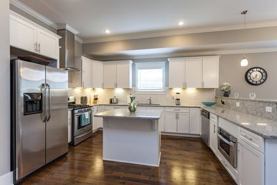 This Enormous kitchen is perfect for entertaining large gatherings.