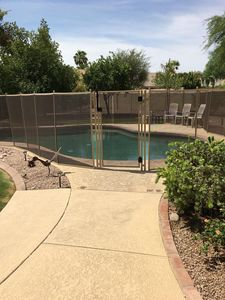 New pool fence with self closing, locking gate.