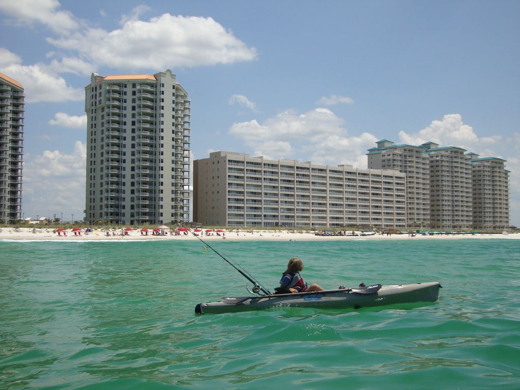 Kayak Fishing Off Navarre Beach With Colony Resort In The Background