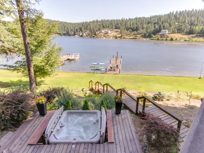 Photo for Luxury lakefront getaway w/ private hot tub - near Gozzer Ranch!