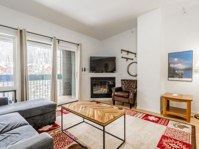 Photo for Sunny condo w/ a furnished balcony, shared pool, hot tub, & gym - walk to lifts!