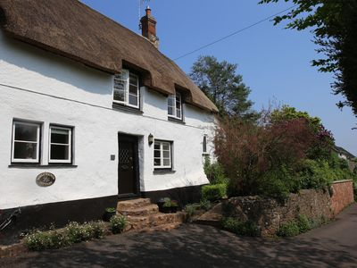 Photo for Delightful Refurbished Grade II Thatched Cottage where Dogs are Welcome