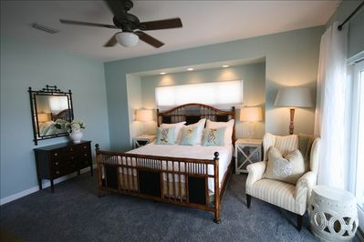Master Bedroom with flat screen TV and balcony overlooking Gulf