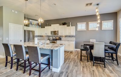 Sophisticated Kitchen with sleek breakfast bar and extra seating for gathering
