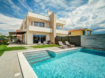 Photo for This 3-bedroom villa for up to 6 guests is located in Novigrad and has a private swimming pool, air-
