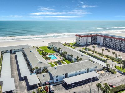 Photo for NEW LISTING! Waterfront living w/ patio, shared pool, & easy beach access