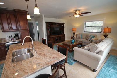 """Very open layout.  New sleeper sofa set, new barstools & a large 55"""" LED tv too."""