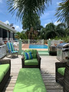 Well appointed decking with ample seating and barbecue adjoining the pool area