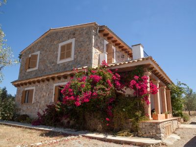 "Photo for Spacious Holiday Home ""Ses Oliveres des Convent"" with Mountain View, Wi-Fi, Balcony, Terraces, Pool & Garden; Parking Available"