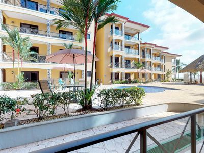 Photo for Elegant beachfront condo with shared pool, upscale fixtures & ocean views!