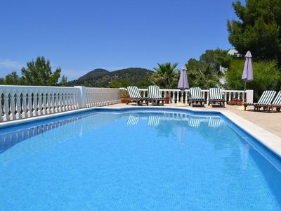 Photo for Stunning villa with sea & sunset views, in walking distance to Cala Salada beach