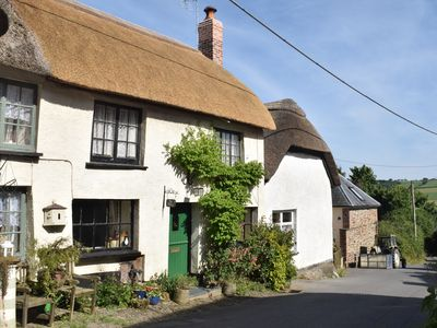 Photo for 17th Century thatched cottage close to Exmoor, Devon sleeps 4