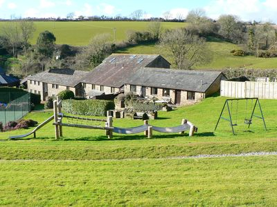 Photo for Holiday on a Converted Cider Farm with indoor pool, tennis court and playroom.