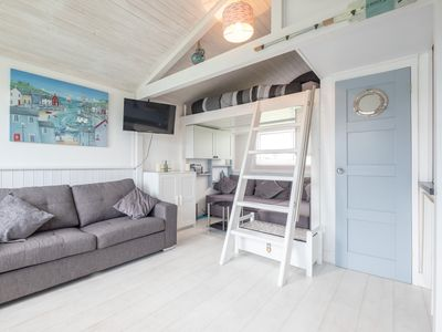 Photo for Stylish, high end chalet with a mezzanine, luxury kitchen & bathroom & parking.