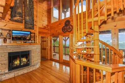 Grand View Lodge - Living Room with Fireplace and Spiral Staircase