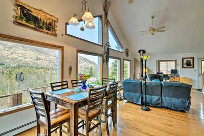 No matter the spot, enjoy views of the mountains at this Eagle River home!