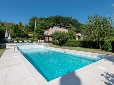 Photo for Stylish Tuscan farmhouse with cascading pool, 15 min from Lucca