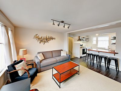Living Room - This property is maintained and managed by TurnKey Vacation Rentals. Modern décor and an open floor plan make this a comfortable spot for a family, a pair of couples, or business travelers.