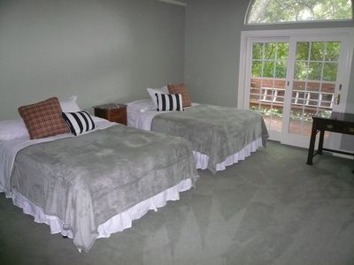 Master bedroom has 2 queen size beds...french doors open onto a private deck