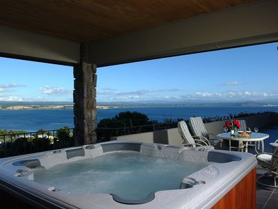 6 person hot tub on covered patio with magnificent lake views