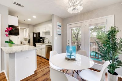 Unit B - The dining area is between the kitchen and living room - the perfect open floor plan!