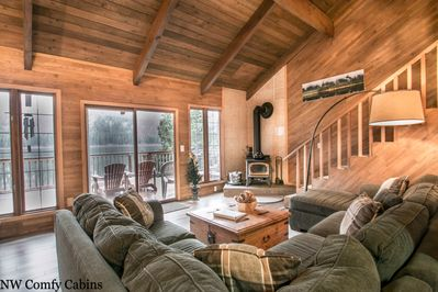 Picture windows that showcase the lake and outside deck