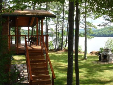 View of the Lake House Deck and Lower Patio Stone fireplace