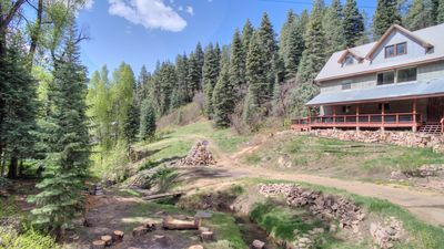 Custom built main house, creek front, with guest house, great for families!