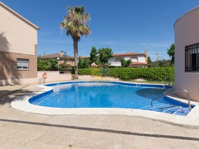 Photo for Beautiful semi-detached house with communal pool in Salou.