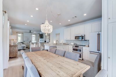 Open concept livingroom, kitchen, dining room brings families & friends together