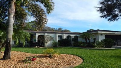 Photo for Tranquil 3 BR, 2 Bath Gulf Coast Pool Home Overlooking Palms Golf Course
