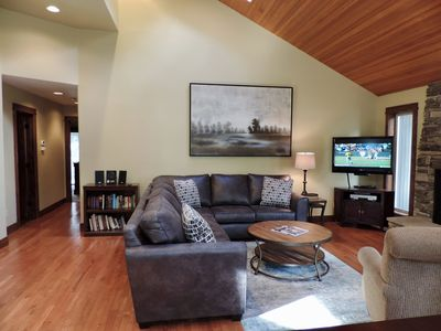 Main living with hall to full bath and bedroom suites, bedroom and bonus room