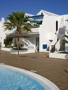 Photo for 2 Heated Communal Pools and a splash pool and Sea Views