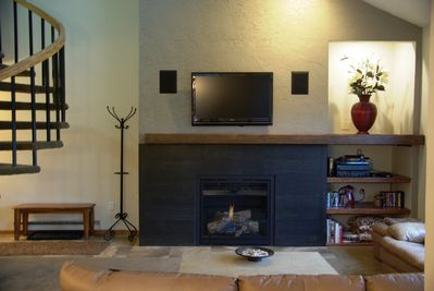 Living area with entertainment center, gas fireplace and comfortable seating