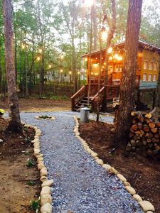 String light and stone paths make this place magical